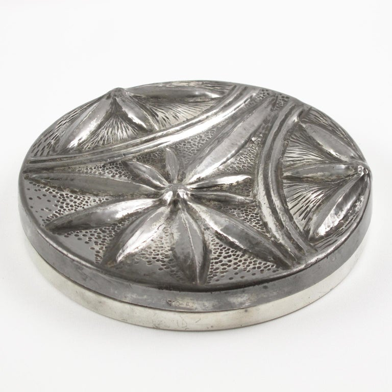 Elegant French Art Nouveau uniquely illustrated a hand-wrought dinanderie pewter covered box by Alice Chanal (1872-1951) and Eugene Louis Chanal (1872-1925). Large round flat shape with typical Art Nouveau floral embossed design. Engraved signature