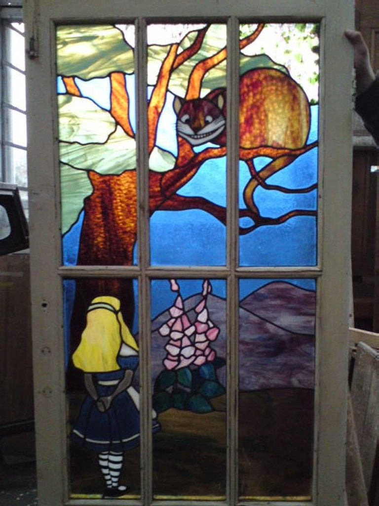 Alice in Wonderland incredible suite of stained and leaded glass set in the original doors and windows,. Please note this suite is in two listings and the price here is for the five pieces in both listings. A one off commission removed from a large