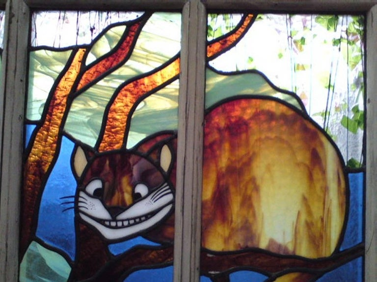 Hand-Crafted Alice in Wonderland, A Five Piece Suite of Stained and Leaded Glass Doors. For Sale