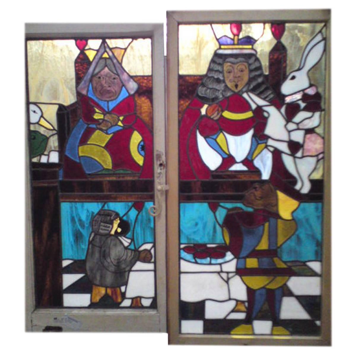 Alice in Wonderland, A Five Piece Suite of Stained and Leaded Glass Doors.