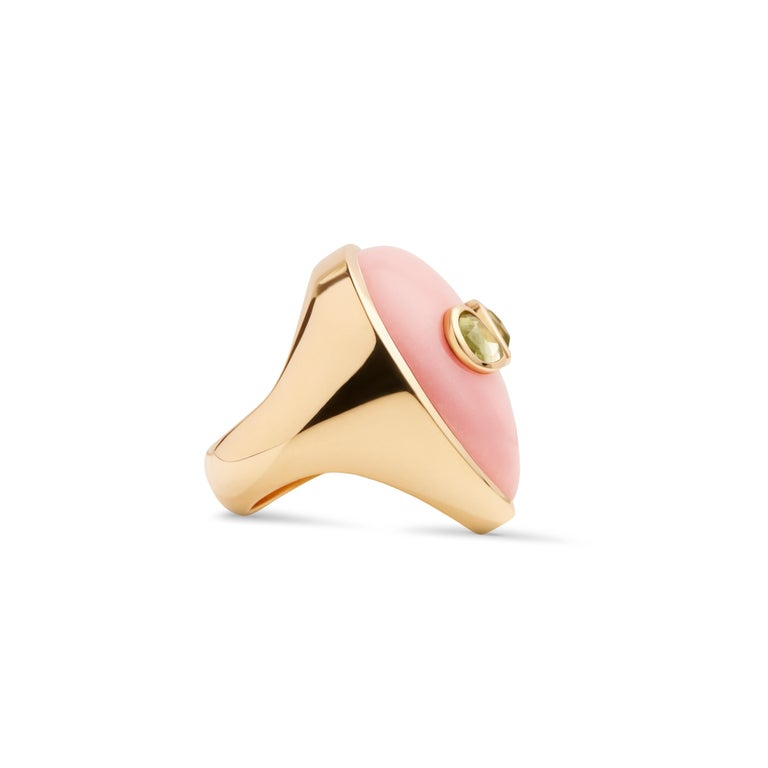 A 90's obsession with aliens and a minimalist aesthetic are the inspiration behind this one of a kind ring. Bright colored stones imitate the fluorescent colors popular in the 90's and bring life to this extraterrestrial face made of pink opal and