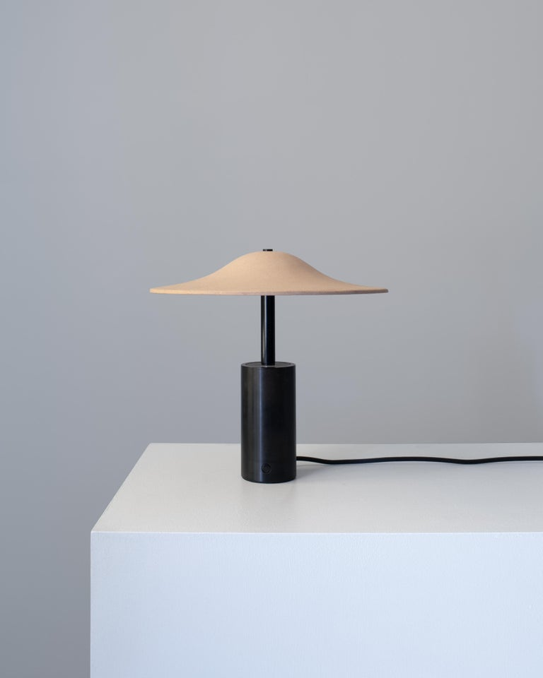 Crafted by hand, the Alien Table Lamp by New York studio In Common With is both decorative and functional adding a sculptural element to any room. The steel bases provides the perfect balance and housing for the light, creating a relaxed bounce