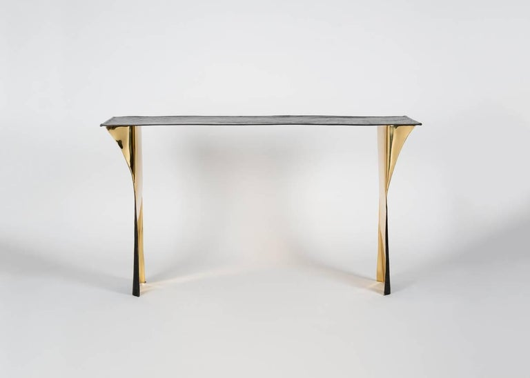 Inspired by Belgian architect Paul Hankar and so slender it might almost disappear were it not for the mirror-like finish of its inner surfaces, this contemporary reinterpretation of an historical object not only stands outside of time, it possesses