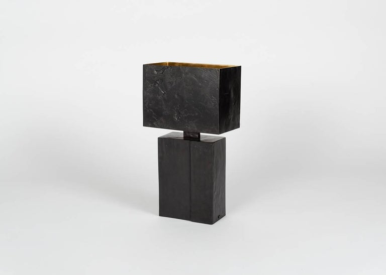 Straddling the line between the subtle and the sturdy, this tactile all-bronze table lamp with its sculptural base and discretely patterned shade is masculine and powerful, yet not overbearing. A quiet statement as suited to the office as it is to