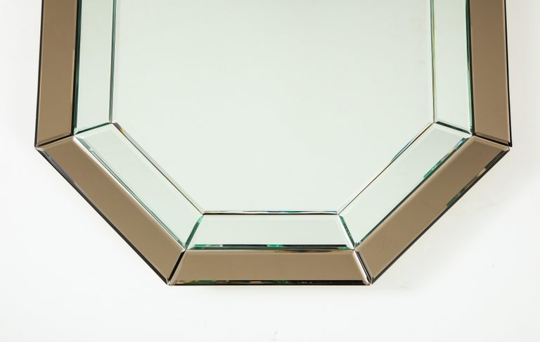 An all-glass Italian octagonal mirror frame with clear and bronze colored glass on the outer segments.  Italy, circa 1970  Size: 33 3/4