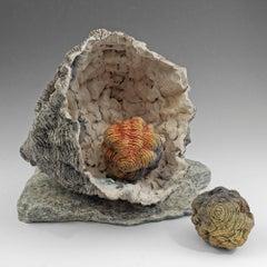 """New Life"", gray, orange and yellow glazed and textured ceramic"
