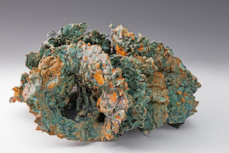 Sea Creature 2, textured ceramic in blue greens, embodies the essence of clay in its organic shapes that refer directly to the earth and nature. The artist says