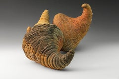 """""""The Kiss"""",  textured ceramic in gold and reddish browns"""