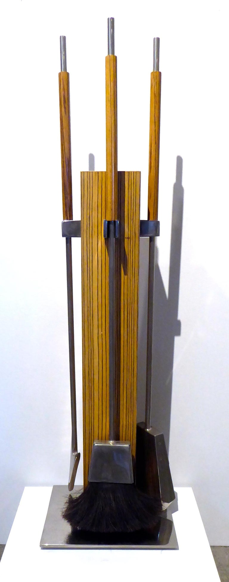 A four-piece zebra wood and chrome-plated steel fire tool set designed by Allessandro Albrizzi in the 1970s. These sets are generally seen in Lucite but the zebra wood was an available option.