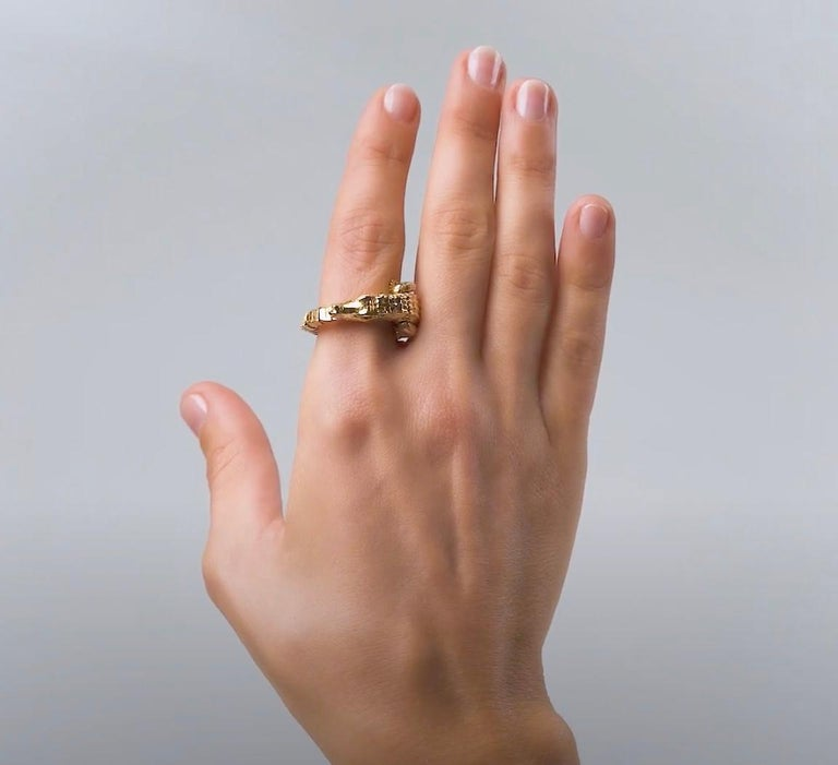 Playful yet with an opulent glamour, this piece is intriguing in its delicate mechanism. Designed as an intricately-crafted alligator in 18k yellow gold, the ring is entirely articulated, so that its body wraps around the finger. The alligator's