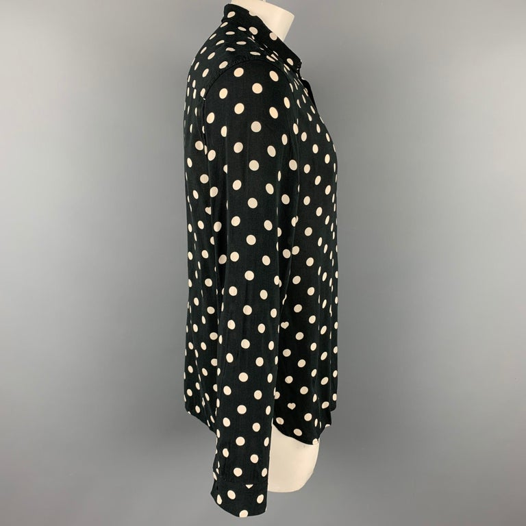 ALLSAINTS long sleeve shirt comes in a black & white polka dot viscose featuring a button up style and a spread collar.  Good Pre-Owned Condition. Marked: XL  Measurements:  Shoulder: 19 in. Chest: 44 in. Sleeve: 28 in. Length: 30.5 in.