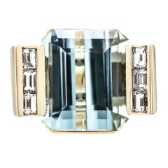 Alluring Aquamarine, Diamond and 14 Karat Yellow Gold Cocktail Ring