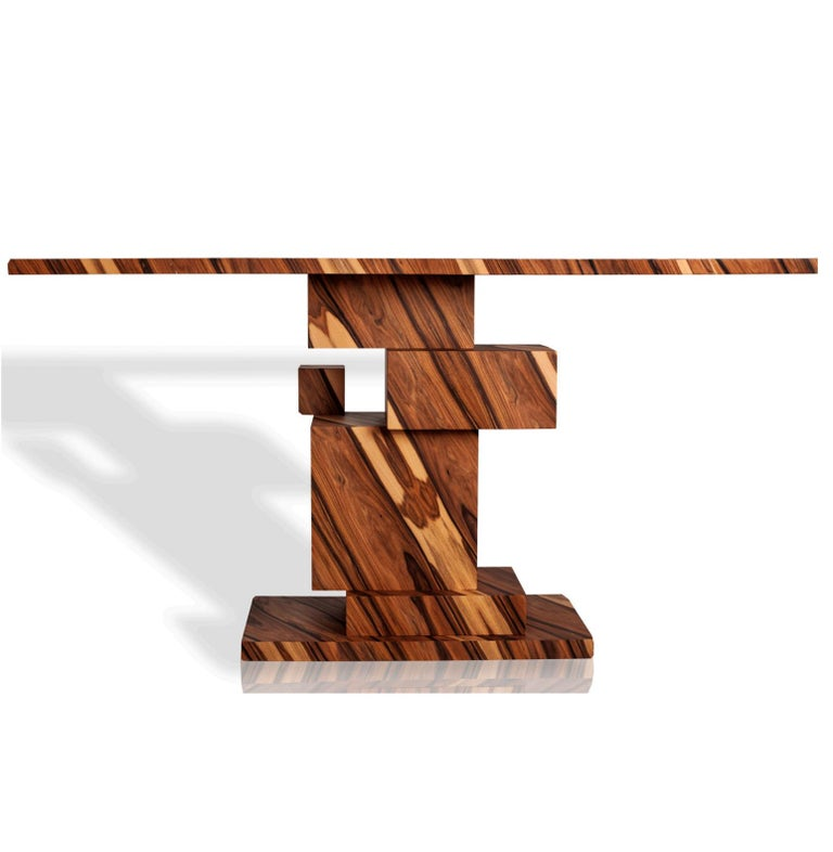Alma Collection is inspired by the power of exotic nature and shamanic magical wisdom. The artisan uses the natural winding lines of the wood to create unique geometrical compositions. The Alma Console features exotic lines of Palo Santo wood from