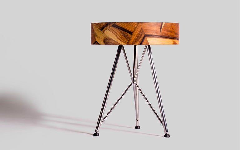 Using the sinuous organic lines of the wood, Alma stool is a creation of unique unrepeatable geometric compositions. The stainless steel legs, homage to the Eiffel style, create a contrast transmitting an independent and elegant energy. The