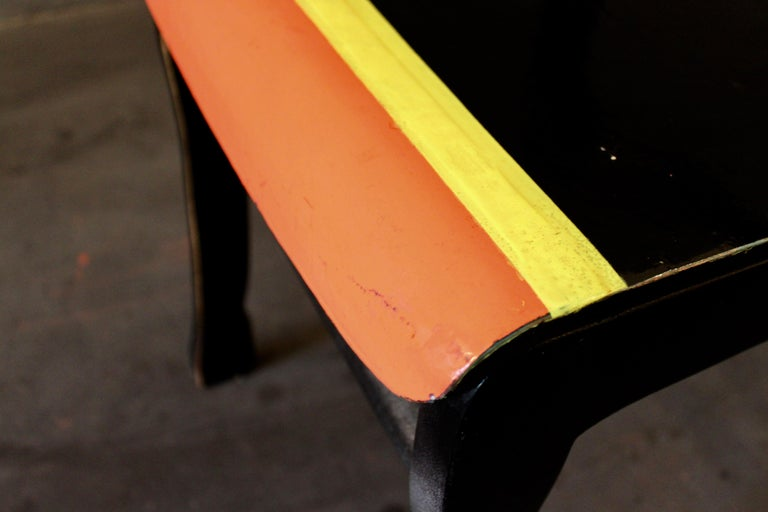 Markus Friedrich Staabs re-work of an early 1970s German design contemporized by re-shaping its original form and mass produced meaning. Painted black with yellow and orange stripes on the seats front, finished with 2K high gloss varnish to preserve