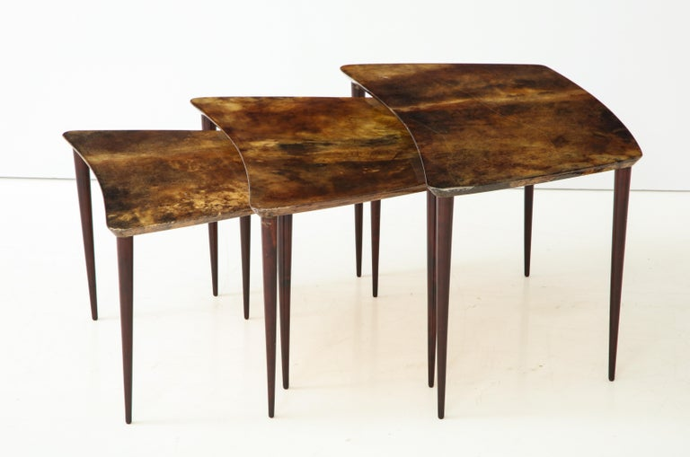 Trio of Italian goatskin or parchment nesting tables, designed by Aldo Tura, Italy, circa 1950s. The large table measures 16.25