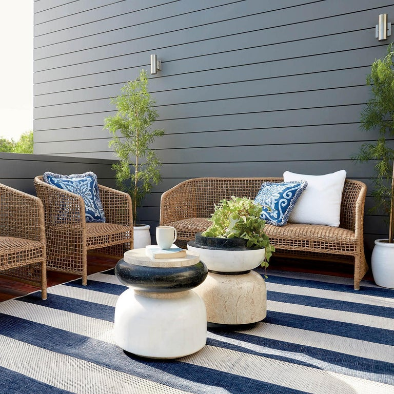 Alpha is a contemporary stool or side table that is available for indoor or outdoor use. The piece features a sculptural silhouette that is perfect for next to a sofa or an armchair or as a stool for a seat in an outdoor patio area. The stool is