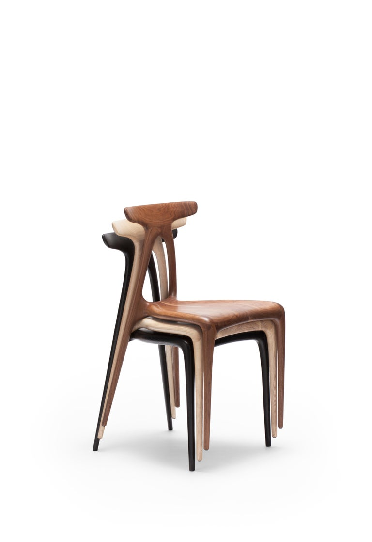 A contemporary solid-wood all-purpose stackable chair produced using the latest production technologies of shaped wooden furniture. The design boasts a strong architectural gesture that gives the chair its inherent strength: the a shaped structure