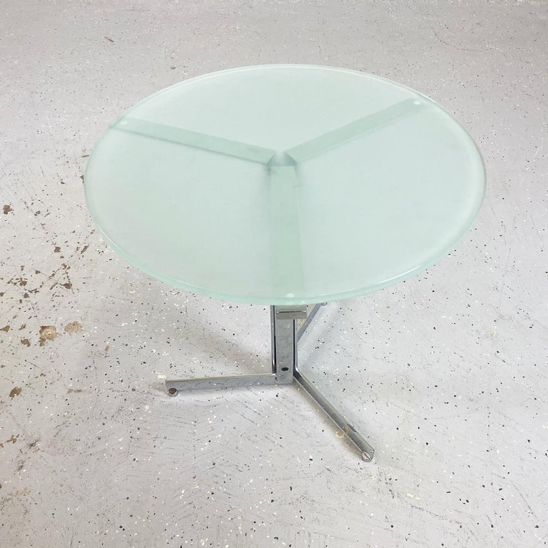 Frosted glass and chrome side table with unique three-legged base. A wonderful mid-century example from Hans Eichenberger.