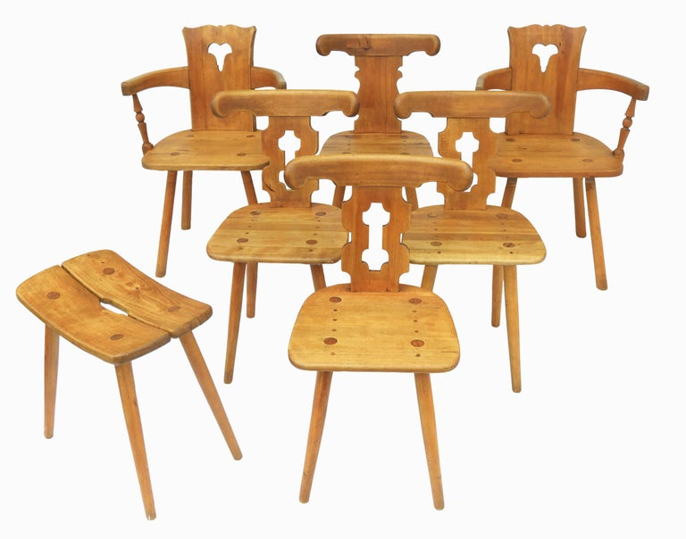 Alpine dining chairs and stool in beech, circa 1970, French, Swiss Midcentury Chalet chairs perfect for a log cabin retreat or modern interior country kitchen Two carvers four chairs and a stool Solid carved beech nice patina In good vintage