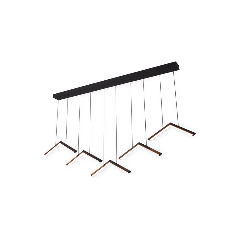 ALPINE V is an extension of the ALPINE chandelier family. With this modular series, several lights can be arranged at different heights to create a custom linear composition.   Metal Finish Powder-coat finishes available in Metallic Gold