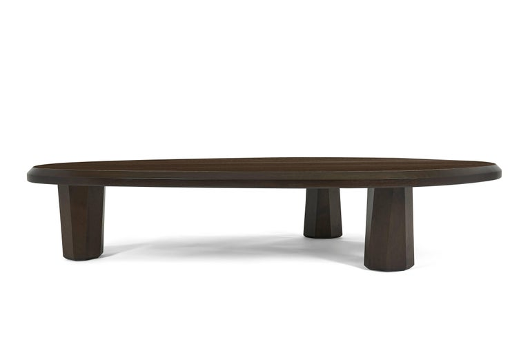Sturdy and sophisticated, the alto coffee table features asymmetrical lines and a rich finish on walnut.