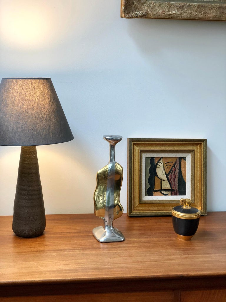 Aluminium and brass Brutalist style candle stand in the manner of David Marshall (circa 1970s). Vaguely assuming the human form, this curvy aluminium and brass candle stand has presence, weight and character. So elegant it can stand on its own in