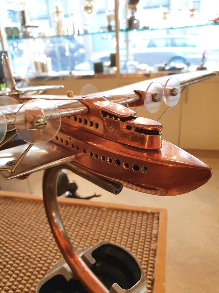 Latécoère 521 'Lieutenant de Vaisseau Paris' (France)  A polished aluminium and copper artisan made desk model in the form of a Latécoère 521, the French six-engined flying boat and one of the first large trans-Atlantic passenger aircrafts, first