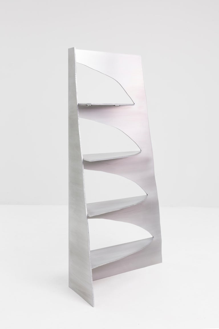 Aluminum rational jigsaw shelf by Studio Julien Manaira Dimensions: 72.5 x 25 x 140 cm Materials: Brushed and waxed aluminum   The intention behind this project is to highlight the traces from the actions of the maker. In this sense, the choice of