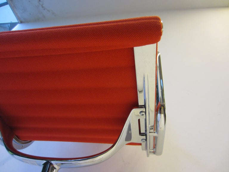 Aluminum Aluminium Red Chair EA 104 Charles & Ray Eames, Vitra For Sale