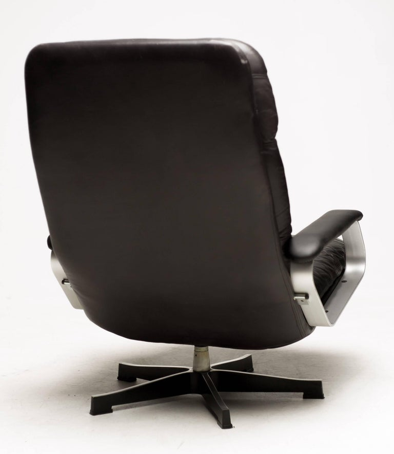 German Aluminum and Black Leather Lounge Chair For Sale