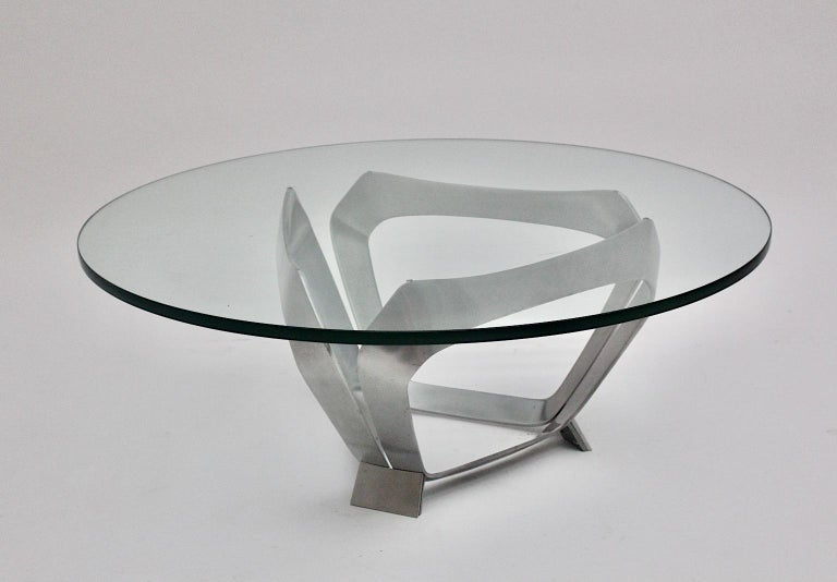 Aluminum glass space age vintage coffee table or sofa table, which was designed by Knut Hesterberg 1960s Germany for Ronald Schmitt. Beautiful aluminum base construction in sculptural form, while the clear glass plate shows polished edges and a