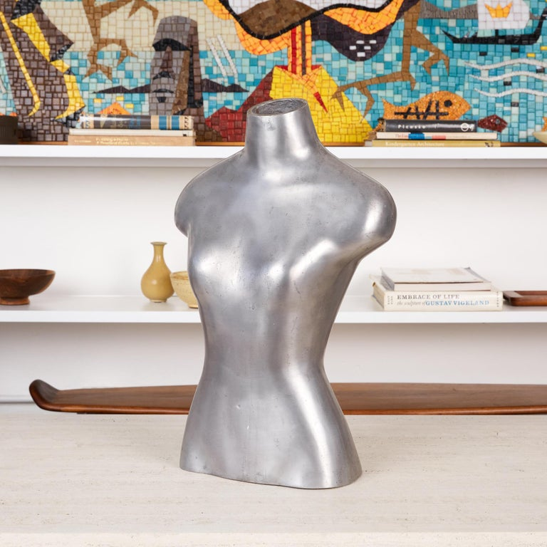 Made out of a material far more interesting than your standard dress form, this oddly unique, mannequin torso is both playful and sleek. A true statement piece that would be well suited as is on a credenza or shelf, it can also be mounted on a post
