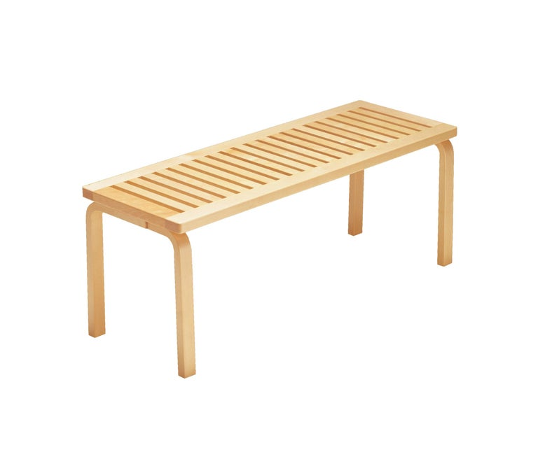 """Alvar Aalto 153A Bench for Artek in Black Lacquer. Designed in 1945 and produced by its original manufacturer, Artek of Finland. Executed in solid birch wood with black lacquer finish. New in box with """"Certificate of Authenticity"""". These benches"""