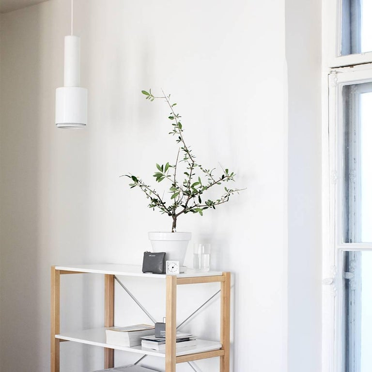 Alvar Aalto A110 'Hand Grenade' white pendant light for Artek. Produced by its original manufacturer, Artek of Finland. Executed in white painted metal and ring with white painted interior and 13 feet of white cord and ceiling canopy. UL listed.