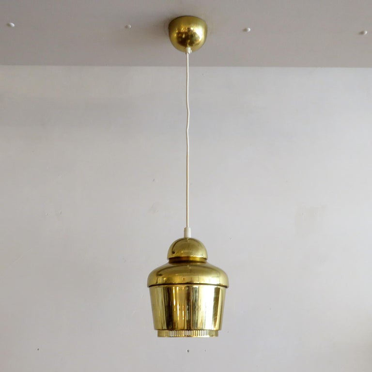 Wonderful 'Golden Bell' pendant light Model A330, designed by Alvar Aalto in 1954, an intricate version with two rings for emitting warm ambient light, first used in the teachers' canteen 'Lyhty', at the University of Jyväskylä, wired for US