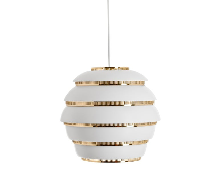 Alvar Aalto A331 'Beehive' pendant light for Artek in white and chrome. Designed in 1953 and produced by its original manufacturer, Artek of Finland. Executed in white painted metal and polished perforated chrome rings with white painted interior