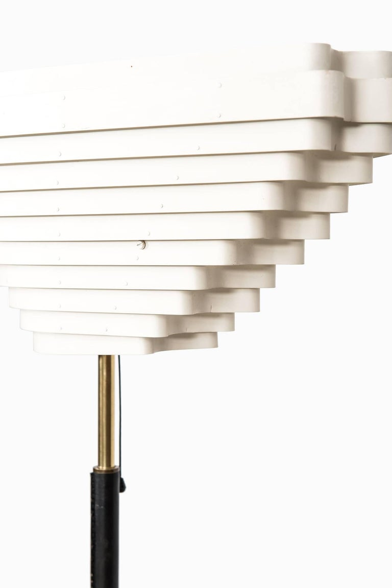 Rare and first production angel wing floor lamp model A805 designed by Alvar Aalto. Produced by Valaistustyö in Finland.