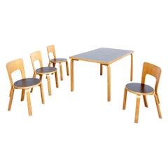 Alvar Aalto Dining Table and Four Chairs, circa 1970