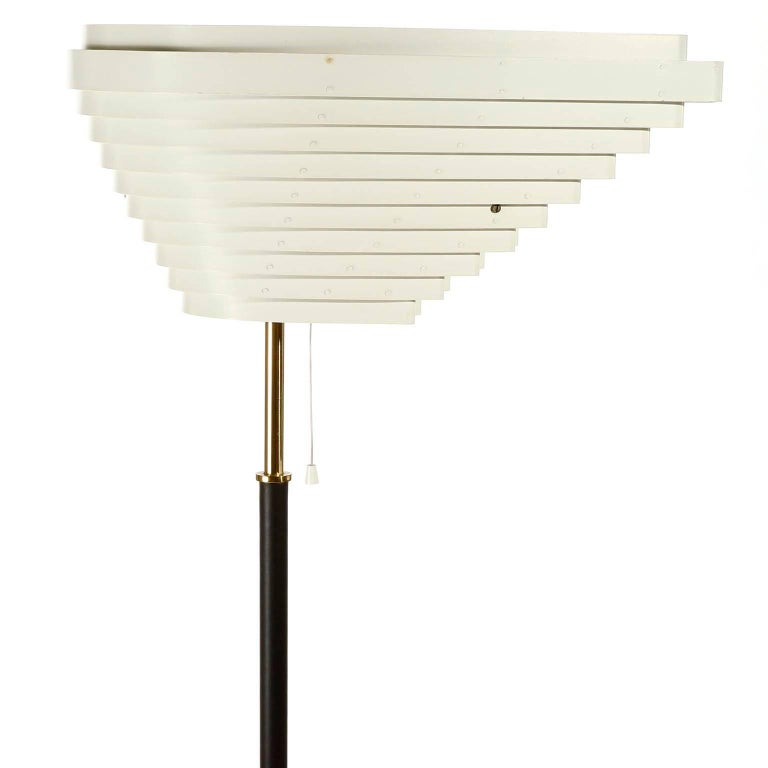 An early floor lamp model A805 'Angel Wing' designed by Alvar Aalto for Valaisinpaja Oy, Finland, manufactured in midcentury, circa 1954. The light originally was designed for the National Pensions Institute in Helsinki.  Base and stem are wrapped
