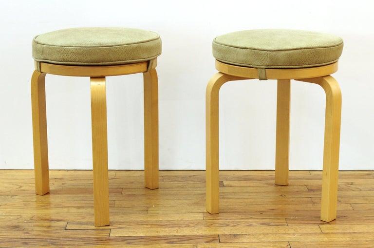 Alvar Aalto for Artek Scandinavian Mid-Century Modern pair of wood stools with snake skin leather upholstery seats. Makers mark on the bottom.