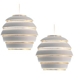 Alvar Aalto for Valaisinpaja Oy 'Beehive' Pendant Lamps in White Metal