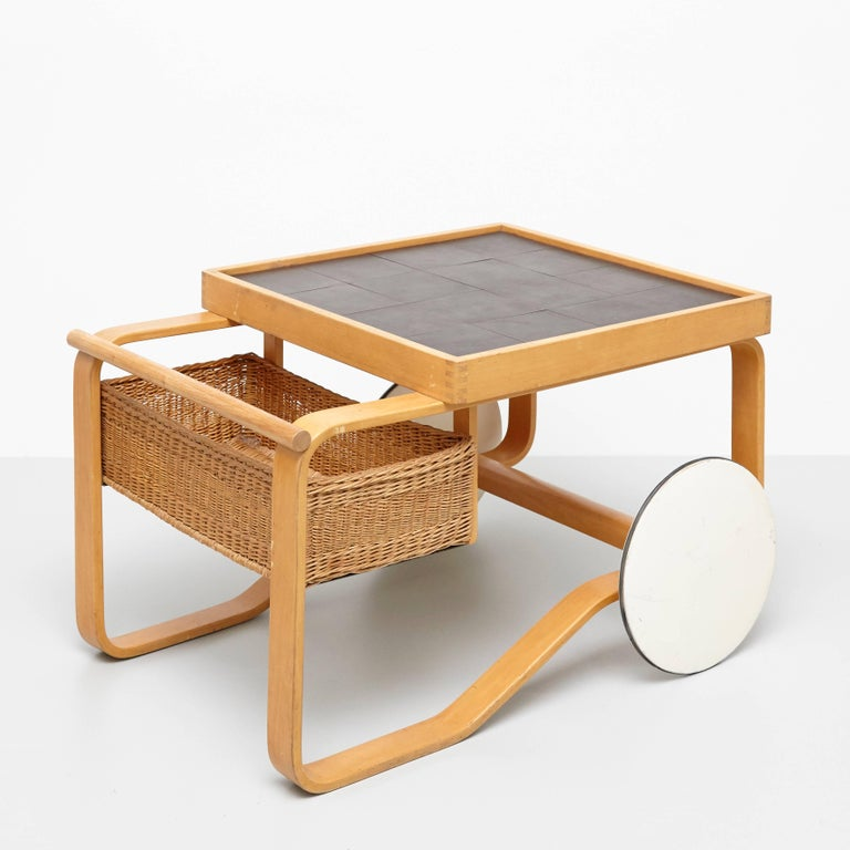 Tea trolley model 900, designed by Alvar Aalto for Artek, Finland, 1935.   Birch, ceramic tiles and cane.  Measures: 64 x 91 x 59 cm  In great original condition, with minor wear consistent with age and use, preserving a beautiful patina.