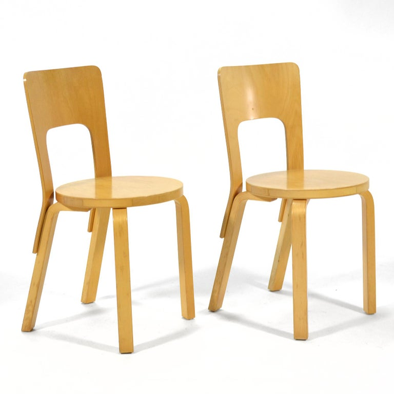 A lovely pair of Alver Aalto's model 66 chair. Produced by Artek, distributed by ICF.