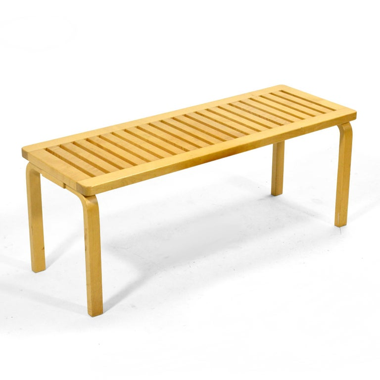 A classic Aalto design, this solid birch slat bench was produced made in Finland by Artek and sold in the U.S. by ICF.