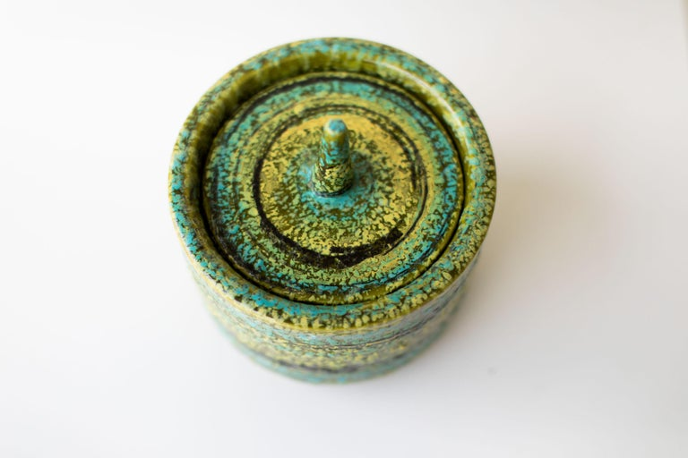 Designer: Alvino Bagni.   Importer: Raymor. Period or model: Mid-Century Modern.  Specs: Pottery  Condition:   This Alvino Bagni Italian Pottery canister Imported by Raymor is in excellent vintage condition. There are no chips or