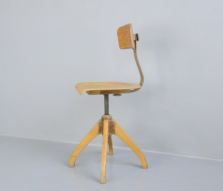 Ama Elastik factory chair, circa 1930s  - Sprung seat - Height adjustable - Shaped ply seat - Curved ply backrest - Original maker decal on the backrest - Made by Ama Elastik - German, 1930s - Measures: 40cm wide x 48cm deep x 93cm tall -