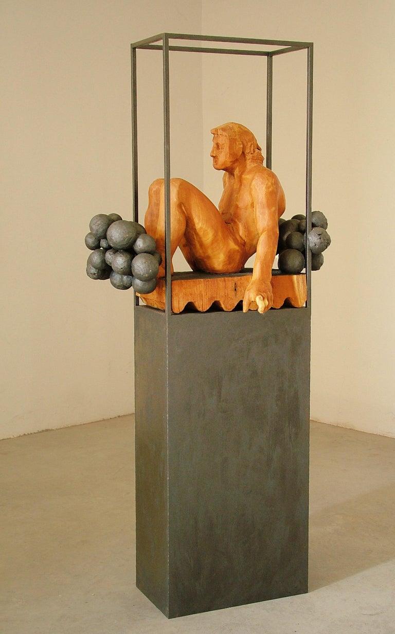 Niebla. iron and wood. original  sculpture - Brown Figurative Sculpture by Amancio González Andrés