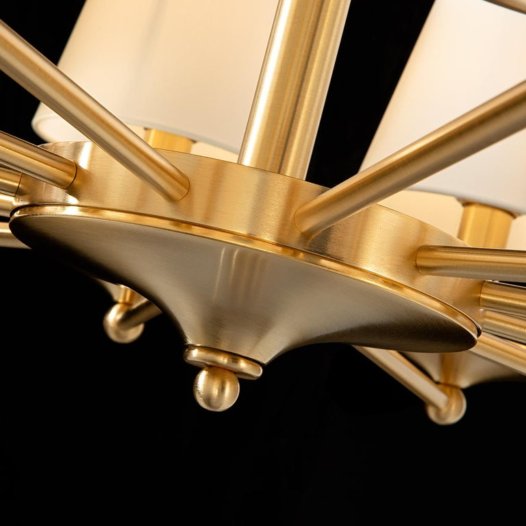 This sophisticated chandelier will be a shimmering and elegant addition to any interior. Boasting a modern allure, it is mounted on a metal ceiling rose and is suspended on a brass and metal chain with a gold finish. The likewise-made structure