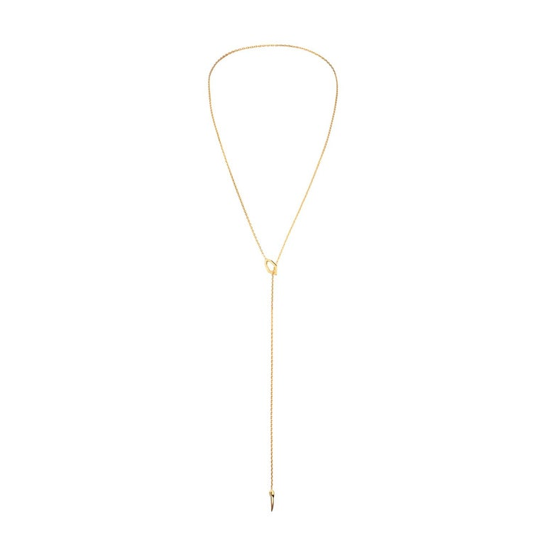 The Amanti Lariat Chain Necklace by Angie Marei features a long 18-karat yellow gold chain with two pendants. A Gothic-era style hexagonal pendant as well as our signature horn amulet, also known as cornicello (Italian for the Devil's Horn). The